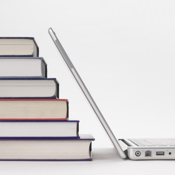 Stack of books and laptop computer