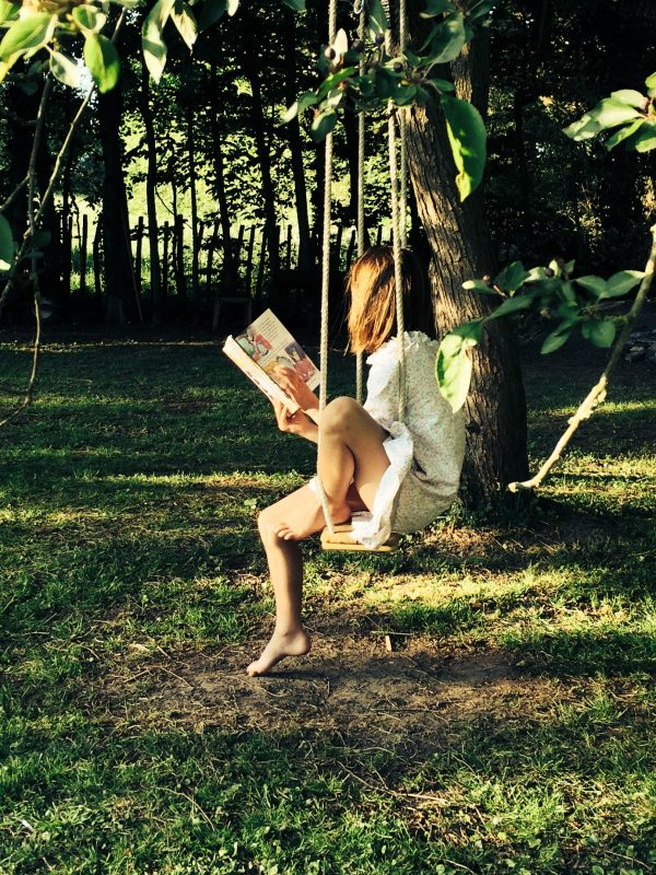 lazy-summer-days-reading-on-swing