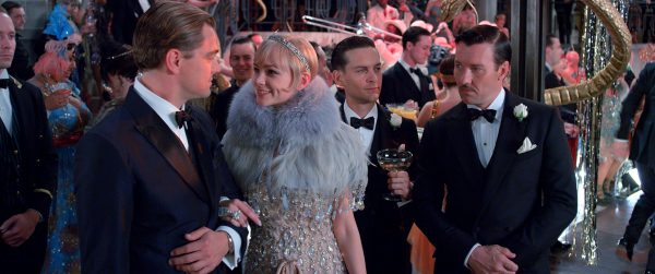 """(L-r) LEONARDO DiCAPRIO as Jay Gatsby, CAREY MULLIGAN as Daisy Buchanan, TOBEY MAGUIRE as Nick Carraway and JOEL EDGERTON as Tom Buchanan in Warner Bros. Pictures' and Village Roadshow Pictures' drama """"THE GREAT GATSBY,"""" a Warner Bros. Pictures release."""